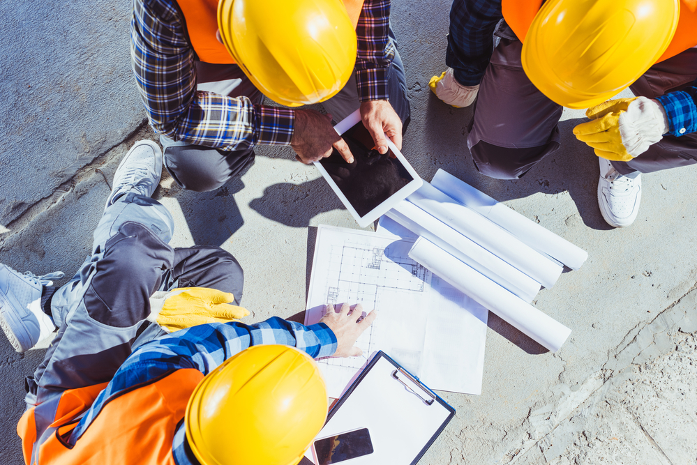 Construction-workers-gathered-to-discuss-building-plans