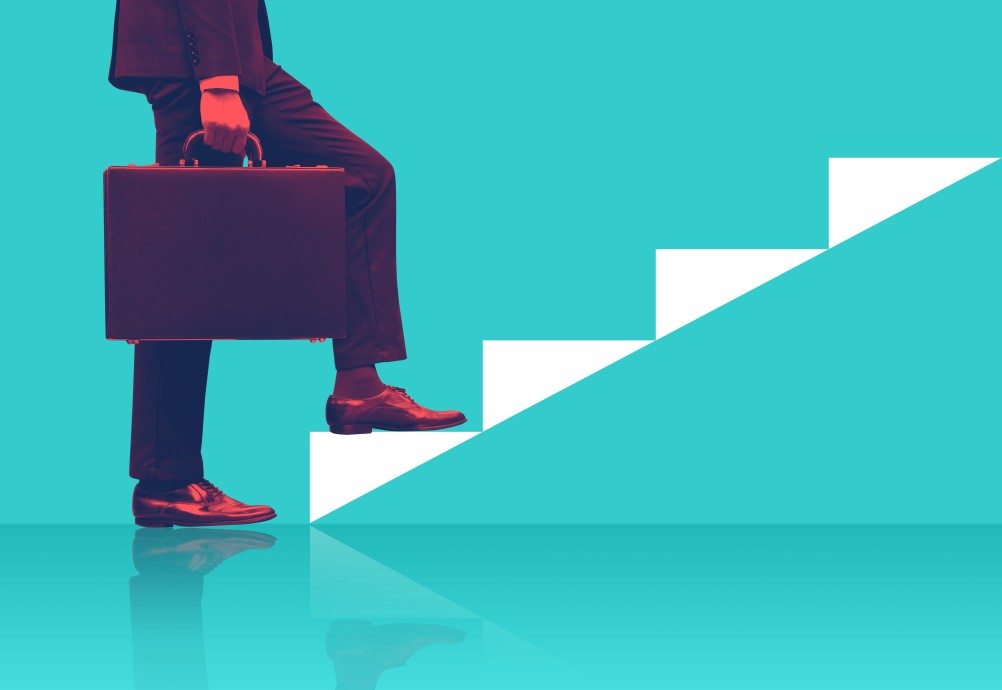 businessman-holding-briefcase-walking-up-graphic-staircase